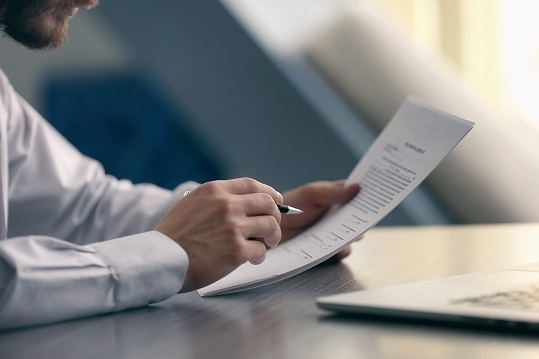 Close up of a businessman reading a document