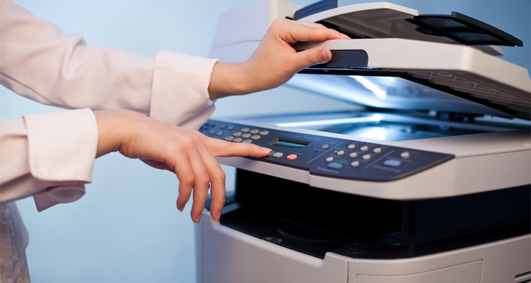 Closeup shot of an employee using an MFP