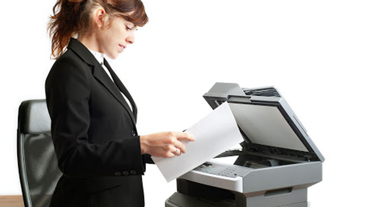 Unauthorized employee reading a document left on the printer