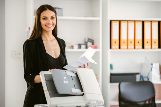 An employee using a newly purchased MFP