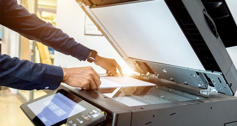 An employee scanning a document