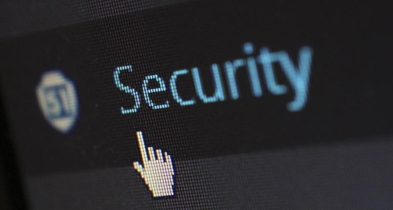 """Closeup on a cursor hovering over the word """"security"""""""