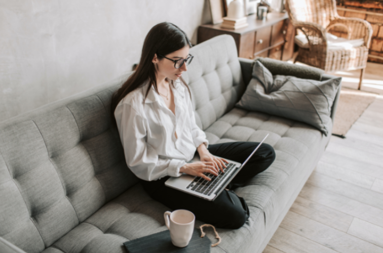 An employee working from home in her living room