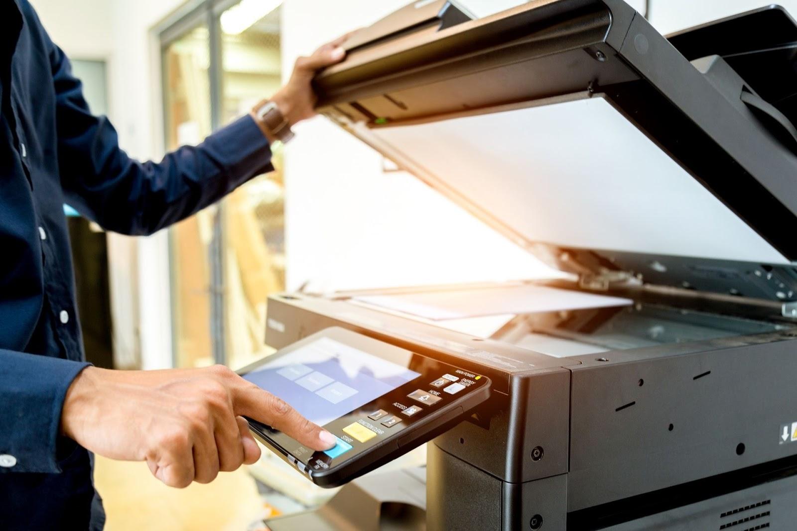 A person using a copier machine