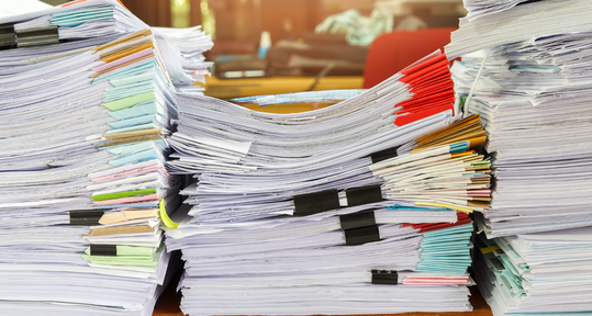 A healthcare worker with a stack of documents