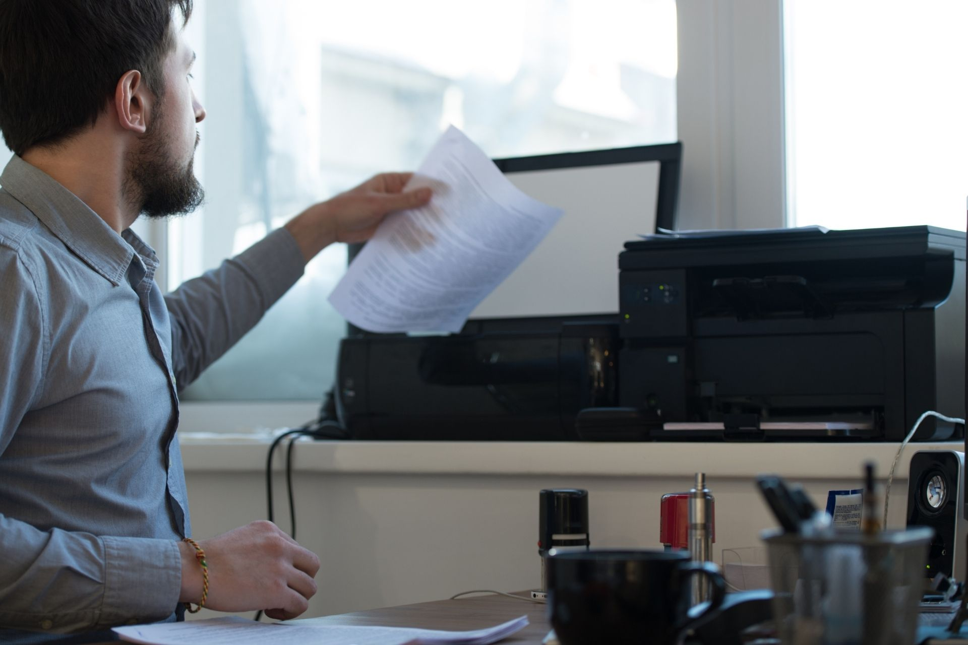 A person using a multifunction printer